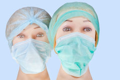 Dummy doctor heads wearing textile surgical cap and mask Royalty Free Stock Image