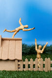 Dummy fall. Dummy theme: Dummy falling from roof stock photo