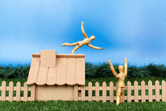 Dummy falling from roof Royalty Free Stock Images