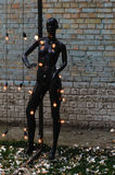 Dummy, female mannequin with lightbulbs Stock Photos