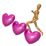 Dummy figure climbing for love Stock Photo