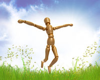 Dummy figure on freedom pose Royalty Free Stock Image