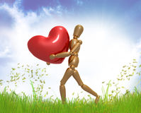 Dummy figure holding valentine heart Stock Images