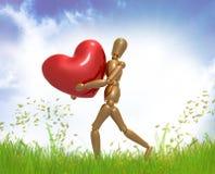 Dummy figure holding valentine heart. Illustration Stock Images