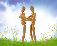 Dummy figures hug each other Royalty Free Stock Photography