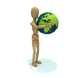 Dummy gives an hug to earth Royalty Free Stock Image