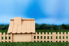 Dummy house. Studio shot of a dummy house with fence and synthetic grass Stock Image