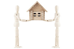 Dummy with house Stock Photo