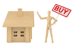 Dummy with house and buy banner Stock Photo