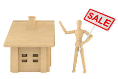 Dummy with house and Sale banner Stock Image