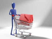 Dummy with house on shopping cart Stock Photos