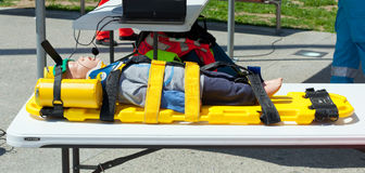 Dummy immobilized on a stretcher for transport. Stock Images