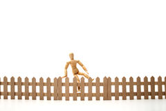Dummy jumping the fence Stock Images