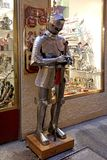 Dummy in knight armor with sword standing outside souvenir shop royalty free stock photos