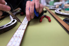 Dummy manufacturing workroom. Worker creating a straight line of led bands Royalty Free Stock Photo