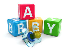 Dummy or pacifier and buzzword blocks with word baby. Stock Photography