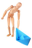 Dummy and paper ship Stock Image