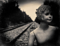 Dummy on railway tracks. Film scan filtered and processed with vintage effect stock images