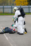 Dummy representing a car accident,firemans provide first aid to injured. Stock Image