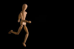 The dummy runner. A dummy running in a black background Royalty Free Stock Photos