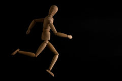 The dummy runner. A dummy running in a black background Stock Images