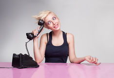 Dummy secretary. With punk style hair trying to answer the phone Stock Photography