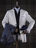 Dummy wearing elegant male suit isolated on checkered background. Fashion men's clothing isolated on checkered background Royalty Free Stock Photography