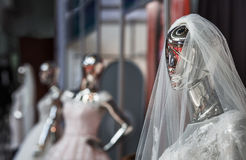 The dummy in a wedding attire of the bride. The dummy looking as liquid terminator, in a wedding attire of the bride, shining the polished metal Stock Images