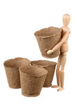 Dummys with peat pots. Wooden dummy with peat pots isolated on white background royalty free stock photos