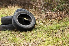 Dump of automobile tires. Environmental pollution. Royalty Free Stock Photo