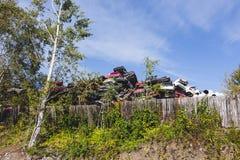 Dump cars. Among the trees Royalty Free Stock Photo