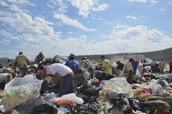 Dump dwellers search for food, recyclables, and items for existence. MAZATLAN, JANUARY 30, 2017: Dump Dwellers sift through the garbage, debris, and refuse of a Royalty Free Stock Photo