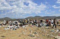 Dump Dwellers sifting through garbage. MAZATLAN, JANUARY 30, 2017: Dump Dwellers sift through the garbage, debris, and refuse of a landfill in the Mazatlan city Stock Photography