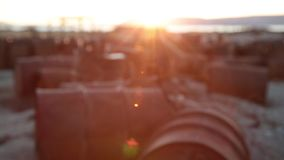 Dump of empty oil barrels. An abandoned industrial zone with empty oil barrels. The video is shot in the sunlight. Dump of empty oil barrels. Used zoom. The stock footage