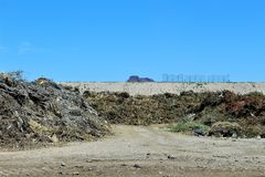 Dump. Landfill where unwanted green waste is disposed of Royalty Free Stock Photos