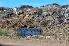 Dump. Landfill where unwanted green waste is disposed of as well as garbage contamination Royalty Free Stock Photography