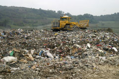 Dump new 4. Refuse collection overview with bulldozer Stock Photo