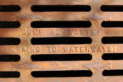 Dump no waste. Close up of water drain Dump no waste! Drains to waterways Stock Photography