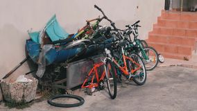 Dump of old bicycles. Broken bikes lying in landfill. Old broken bicycles thrown into landfill. Old rusty bikes lying around. Rust. Y bikes wallowing in backyard stock footage