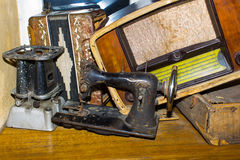 The dump the old stuff -  sewing machine. The dump the old stuff - old sewing machine, radiogram, primus, suitcase, accordion - retro background Stock Image