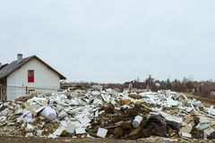 Dump in a residential area. Construction waste illegally thrown away in a residential area stock photos