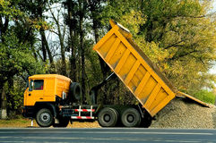 Dump truck. A dump truck dropping off a load Stock Photo