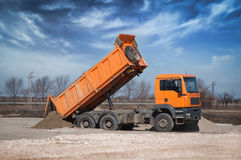 Dump Truck. Off load the clay on the construction site Stock Images