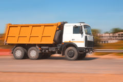 Dump truck. Big powerful dump truck goes on road Stock Images