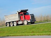 Dump truck. Heavy equipment truck delivering materials to job site Stock Images