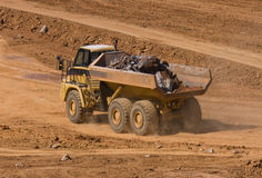 Dump Truck. A dump truck hauling rocks at a construction site Royalty Free Stock Photo