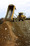 Dump truck. Removing the rubble of a demolition Stock Photos