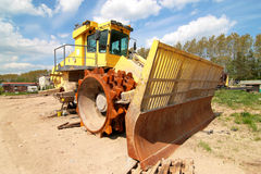 Dump truck. Heavy dump truck against blue sky operating in a sand Stock Images