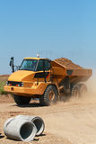 Dump truck. A giant yellow dump truck Royalty Free Stock Images