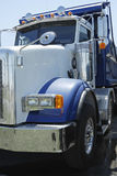 Dump truck. Close up of a white and blue dump truck Stock Photography